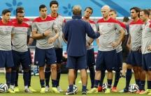 USA national soccer team head coach Jurgen Klinsmann (C) speaks to his players ahead of their training session in Manaus.