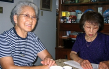 Atomic bomb survivor Teruko Namura (left) with a friend at her home in Los Angeles.
