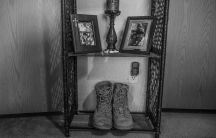 Brandon Ladner. Pelham, Alabama. Ladner's Marine Corps boots sit on a small shelf in his bedroom. Ladner was a US Marine Corps vereran who fought in Afghanistan's Helmand Province. He shot himself inside his living room, and thee bullet remains lodged in