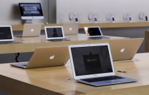 Rows of Apple laptop computers
