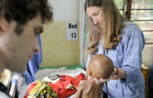 Dr. Terrie Taylor examines a child in the malaria ward of Queen Elizabeth Hospital in Blantyre, Malawi.