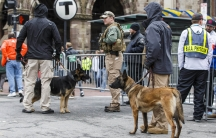 Security personnel stand along Boylston Street near the finish line of the 119th Boston Marathon, held on April 20, 2015.