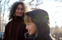 Danielle Meitiv waits with her son Rafi, 10, for Danielle's six-year-old daughter, Dvora, to be dropped off at the neighborhood school bus stop in Silver Spring, Maryland.