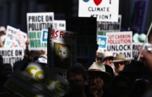 Protesters carrying placards attend a rally in favor of taxing carbon emissions in Melbourne, Australia, on March 12, 2011.