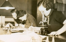 In an archive photo, student Mary Duke Webber uses a microscope at Duke University at some time in the late 1930s.