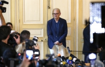 French writer Patrick Modiano poses for journalists in Paris on October 9, 2014, after he was declared the winner of the 2014 Nobel Prize for Literature.