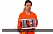 Screenshot of the video message from the Islamic State, in which a man believed  to be Kenji Goto warns that there are only 24 hours left to save his life and even less time for a Jordanian air force pilot Muath al-Kasasbeh, who is also being held hostage