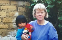 Nancy Bailey, pictured in the 1990s with some of the children in her school, has been found not guilty of child trafficking charges.