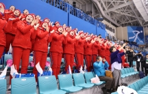 North Korean cheerleaders root for the joint Korean women's hockey team.