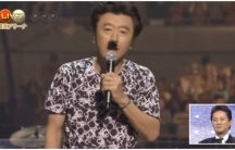 Keisuke Kuwata wears a fake Hitler mustache at the start of the 2014 Red and White Song Competition, a major New Year's Eve institution in Japan.