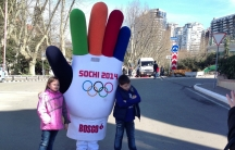 Children pose for a picture outside of the Sochi Olympic Park.