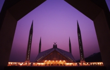 A view of Pakistan's landmark Faisal Mosque at sunset October 8, 2002.