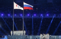 The Paralympic flag, left, is seen beside the Russian national flag during the opening ceremony of the 2014 Paralympic Winter Games in Sochi, March 7, 2014.