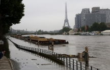 Barges are moored together near the Eiffel Tower