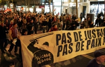 French youth take part in a protest against the government's handling of recent urban unrest in France, at Place Saint Michel in Paris, November 16, 2005.