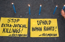 Human rights advocates offers prayers and lights candles