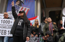 Activists call for more support for Puerto Ricans displaced by Hurricane Maria during a rally at Thomas Paine Plaza.