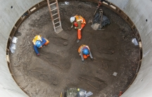 Archaeologists work on unearthed skeletons in the Farringdon area of London in this undated handout photograph released March 15, 2013. Archaeologists said on Friday they had found a graveyard during excavations for a rail project in London which might ho