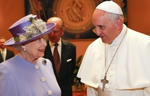 Britain's Queen Elizabeth talks with Pope Francis during a meeting at the Vatican April 3, 2014.