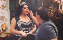 Jaqueline Valencia touches up her sister Kimberly's make-up during Kimberly's ranch-themed photo shoot.