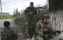 Pro-Russian armed men take positions near the town of Slaviansk, eastern Ukraine, May 5, 2014. Pro-Russian separatists ambushed Ukrainian forces on Monday, triggering heavy fighting on the outskirts of the rebel stronghold of Slaviansk, Interior Minister