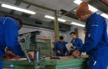 At the Cottbus Chamber of Crafts trainees enrolled in a refugee training program prepare for the day's metalworking assignment, in Cottbus, Brandenburg, Germany, Jan. 11, 2017.