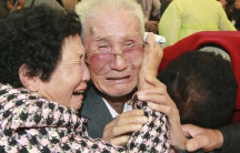 Tearful reunion between families separated by the North and South Korean war.