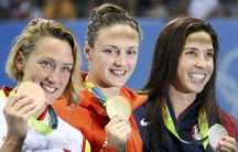 women athletes swimming with medals in Rio Olympics 2016