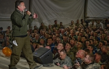 Robin Williams entertains troops during a USO performance.