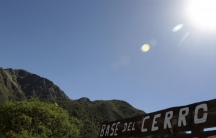 A sign marking the base of the Uritorco hill is seen in the Argentine city of Capilla del Monte, in Cordoba province, December 20, 2012. The mountain is popular among UFO spotters in Argentina.