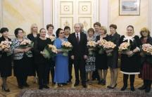 Russian President Vladimir Putin celebrates International Women's Day at the Kremlin in Moscow March 8, 2015.