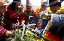 Peruvian shamans holding a poster of US Republican presidential candidate Donald Trump perform a ritual of predictions for the new year at Morro Solar hill in Chorrillos, Lima, Peru, Dec. 29, 2015. The ritual is an end-of-the-year tradition and the shaman