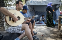 Salim Noah plays guitar