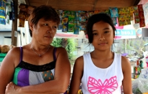 Delma Yerro, 53, and her granddaughter Heavenly at their sari-sari store in Tacloban, Philippines.
