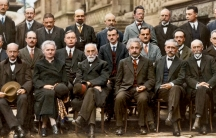From the October 1927 Fifth Solvay International Conference on Electrons and Photons. Hendrik Lorentz, Leiden University, seated between Madame Curie and Einstein, chaired the conference.
