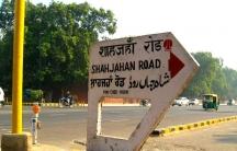 Indian street sign in four languages: Hindi, English, Punjabi and Urdu.