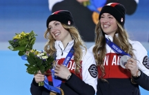 Gold medalist Justine Dufour-Lapointe of Canada poses with silver medalist Chloe Dufour-Lapointe. The sisters competed in the women's freestyle skiing moguls at the Sochi Winter Olympics. A Canadian TV host criticized how CBC announcers were pronouncing t