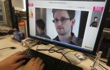 A picture of Edward Snowden, a contractor at the National Security Agency (NSA), is seen on a computer screen displaying a page of a Chinese news website.