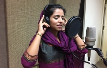 Sonita Alizadeh sings inside of the recording studio at her high school in Utah.