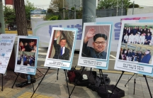 Positive signs celebrating the Inter-Korean Summit are seen near Seoul Station the day before on April 26, 2018.