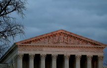 The top of US Supreme Court building is lit at dusk in Washington, Dec. 18, 2017.