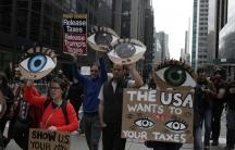 People march demanding U.S. President Donald Trump release his tax returns, in New York, April 15, 2017.