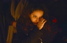 A woman in Trafalgar Square weeps at a vigil for victims of the London terrorist attack