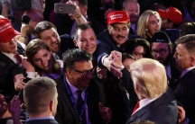 US President-elect Donald Trump greets supporters