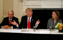 Flanked by Blackstone CEO Stephen Schwarzman, left, and General Motors CEO Mary Barra, US President Donald Trump holds a strategy and policy forum
