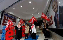 "Women wave ""Yes"" flags at a campaign office of the ruling AK Party"