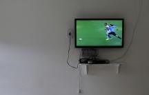 A TV plays a soccer match