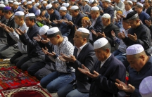 Muslims attend a mass prayer at the Dongguan Great Mosque, in Xining, Qinghai province, China.  The Islamic State has a song in Mandarin calling on Chinese Muslims to join the jihad.