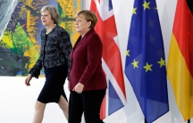 German Chancellor Angela Merkel and Britain's Prime Minister Theresa May arrive for a statement prior to a meeting at the chancellery in Berlin, Germany, November 18, 2016.