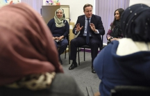 UK Prime Minister David Cameron speaks with women attending an English language class during a visit to the Shantona Women's Centre in Leeds, Britain, on Jan. 18, 2016.